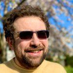 Martin Avila standing outside on warm, sunny day wearing sunglasses