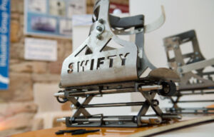 Metal snow board binding with SWIFTY cut out of side
