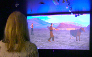 Person watching virtual reality scene on a screen